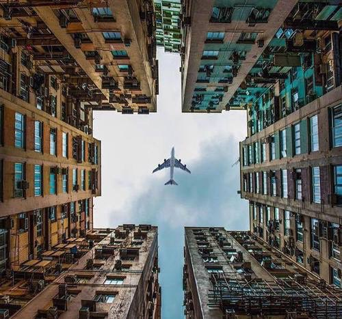 Airplane buildings perspective photography sky image for Building photography